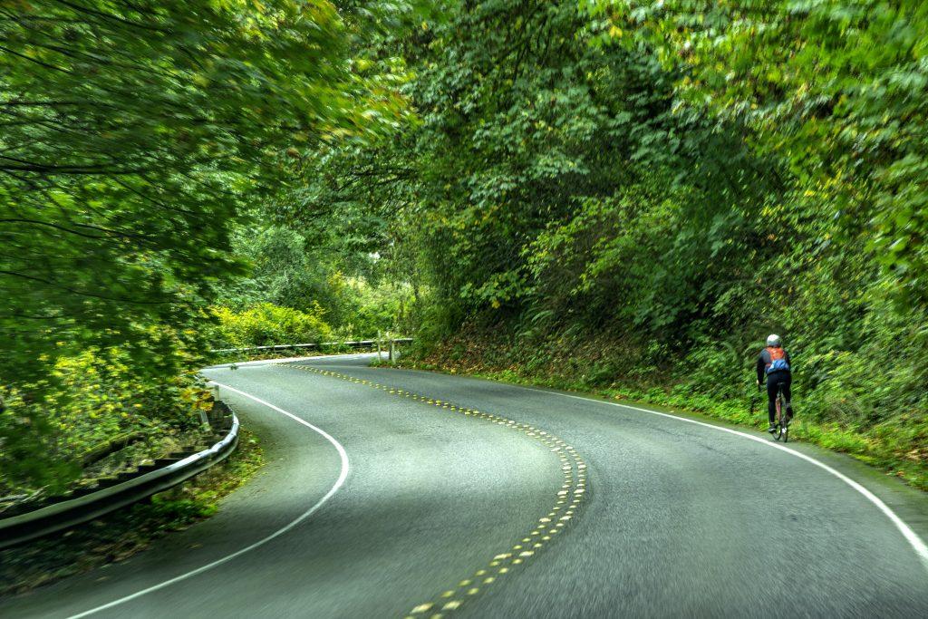 A bike rider on Washington Highway 509 near Dash Point State Park, Federal Way, Washington