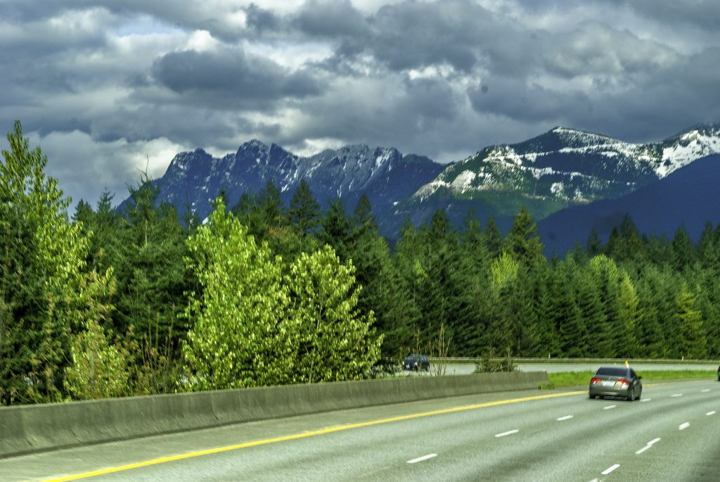 Interstate 90 heading east from Seattle toward the Cascades and Snoqualmie Pass.