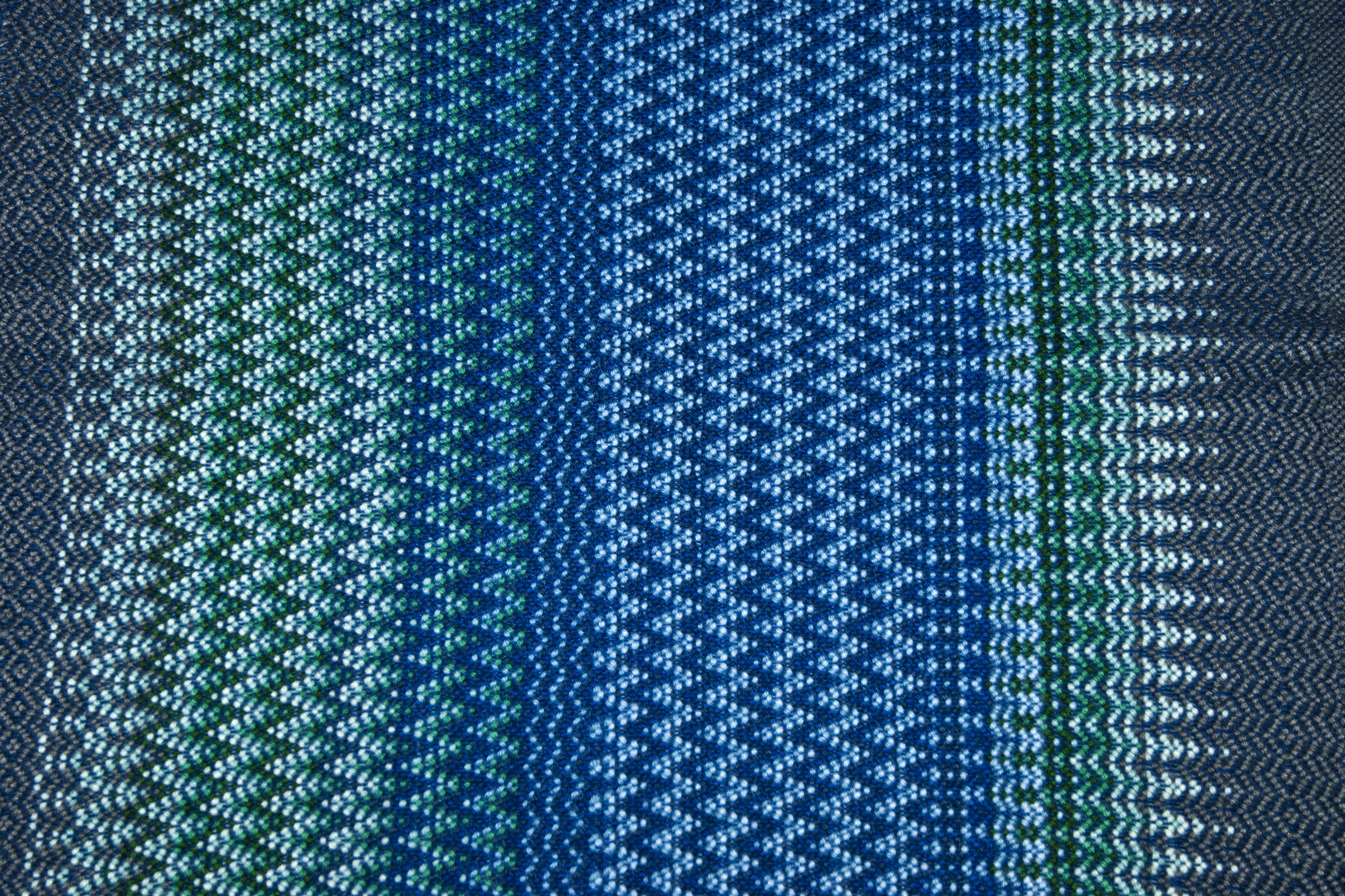 Norwegian Krokbragd using acrylic yarn in shades of blue.
