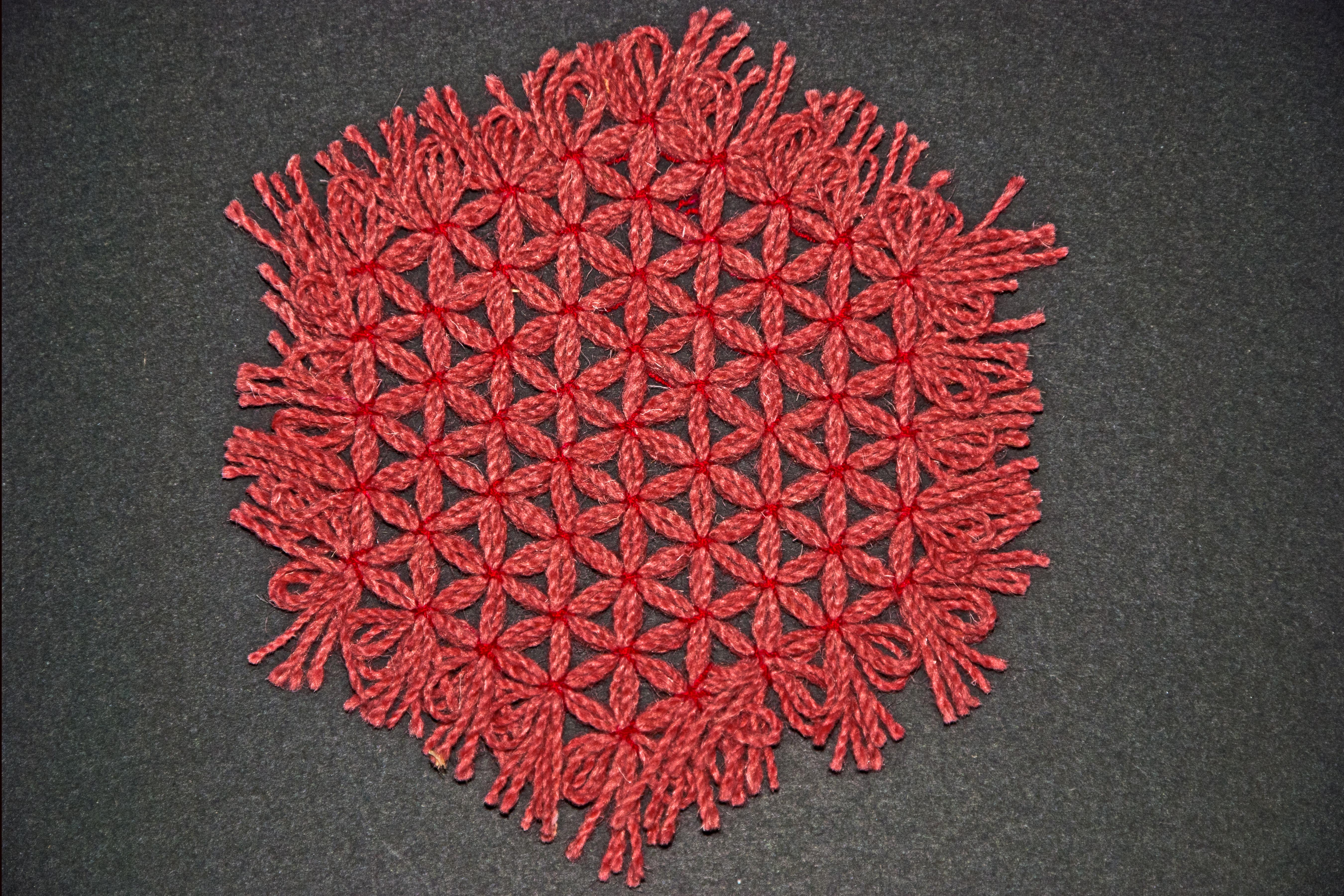 Cloth trivet woven on a hexagonal loom