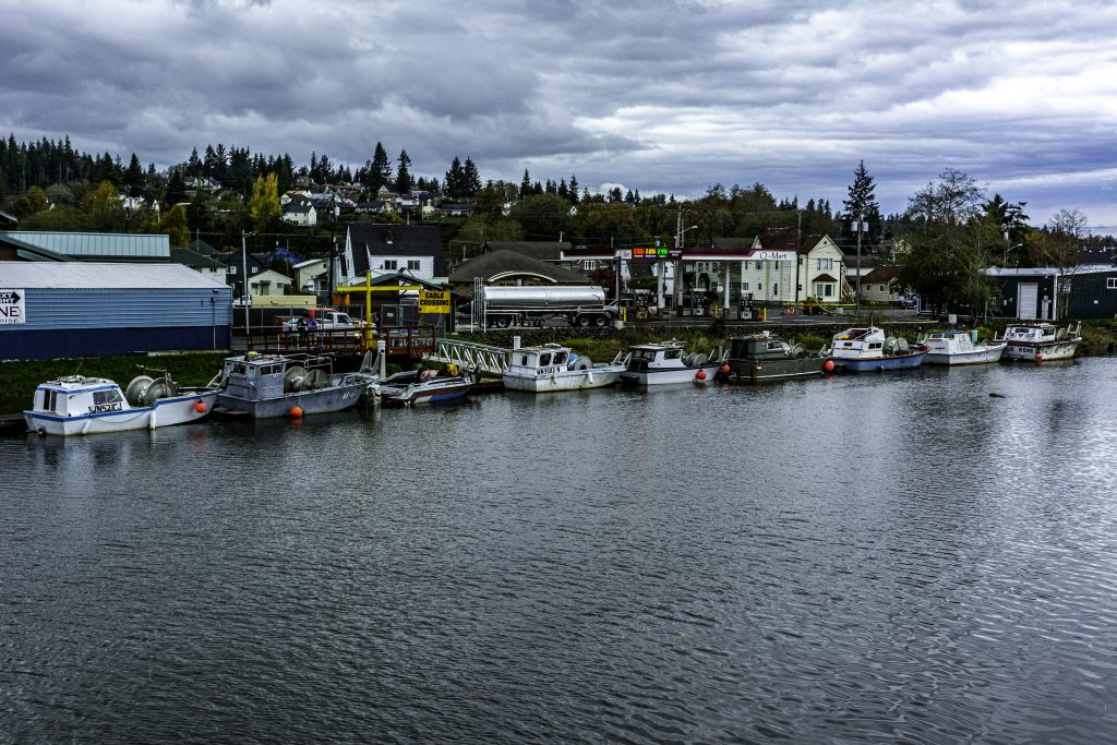 Boats moored on the west bank of the Wishkah River, Aberdeen, Grays Harbor County, Washington.