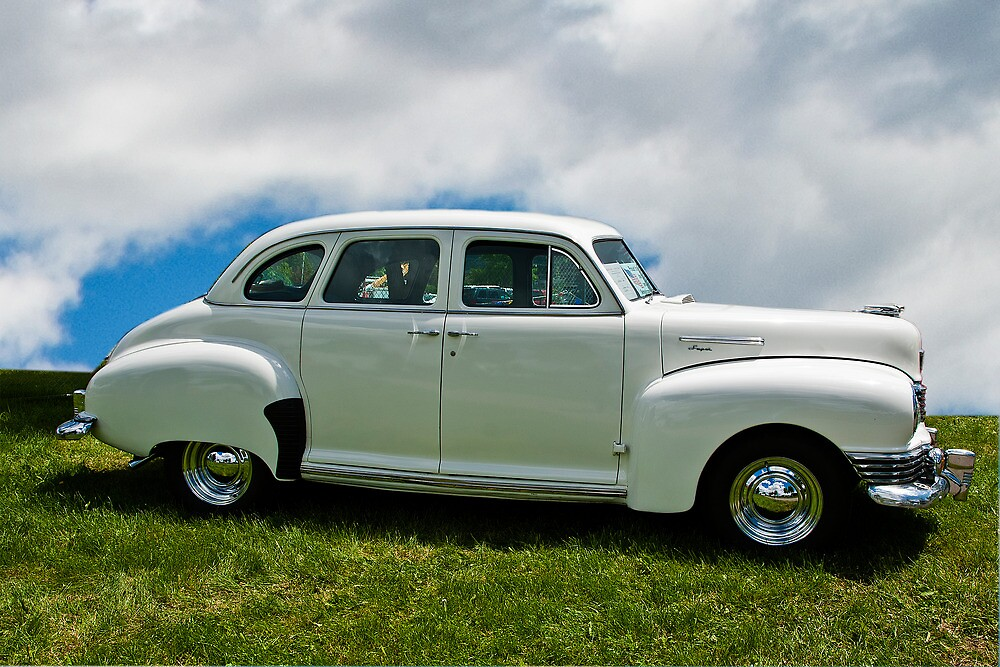 A white 1948 Nash Super on display at a car show in Missoula