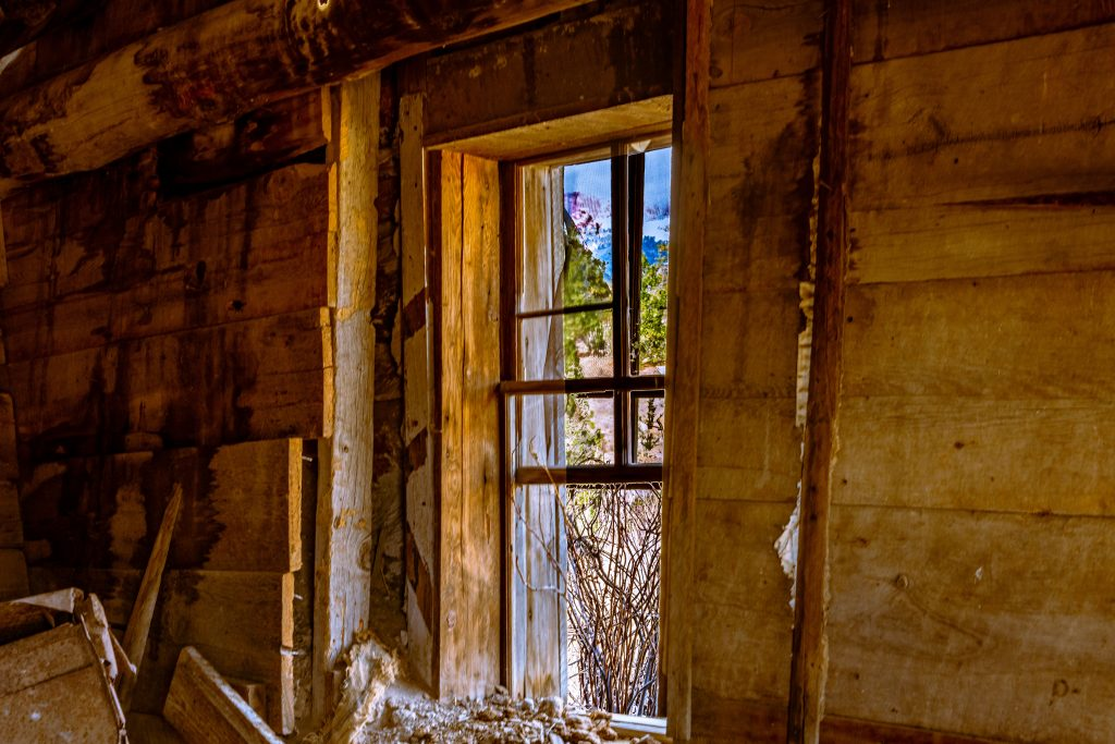An HDR image of a window scene taken from inside an old cabin