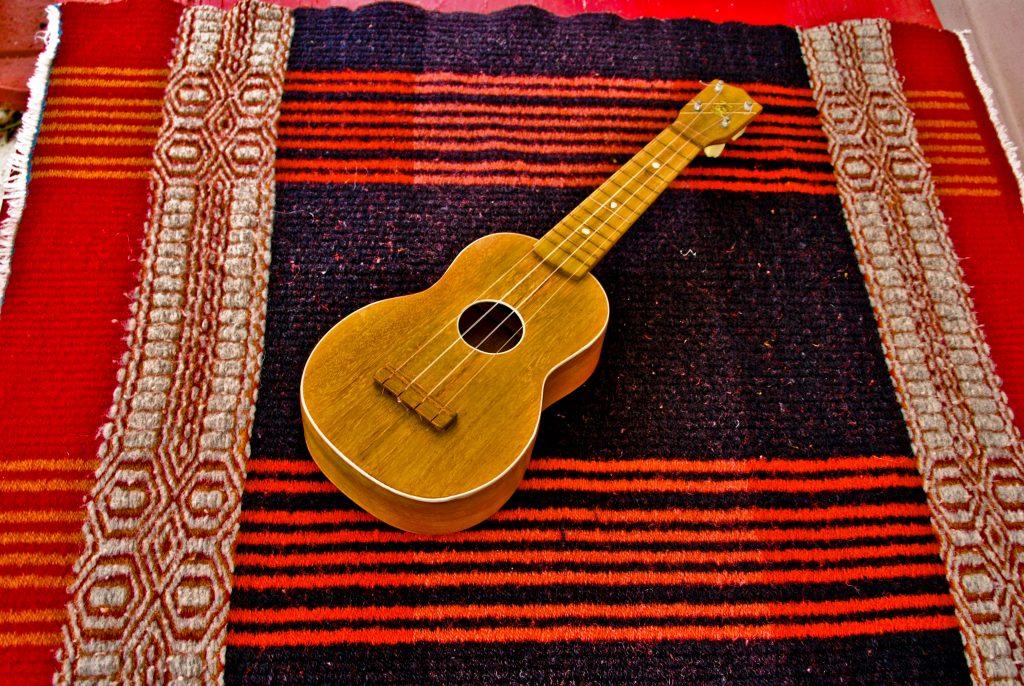 Hawai'ian Ukulele on hand woven lap rug