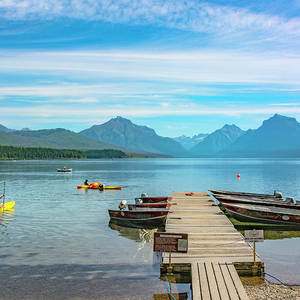 A View of the dock and kayakers on Lake McDonald in Glacier National Park