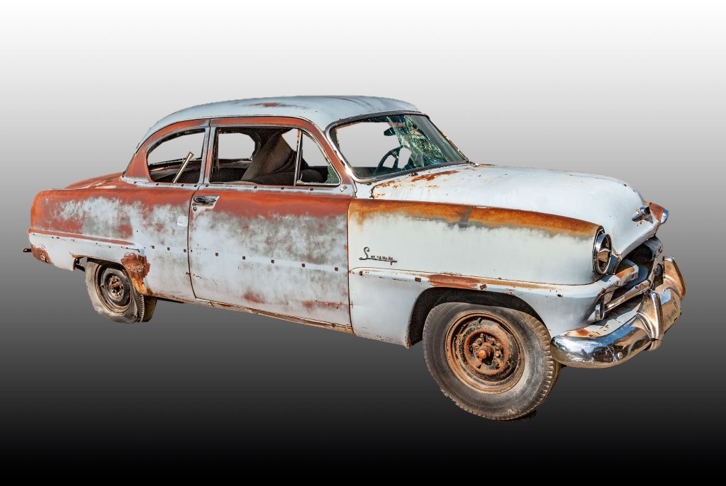 a derelict 1954 Plymouth Savoy Coupe.  Fixing this car up would definitely require a change in plans.