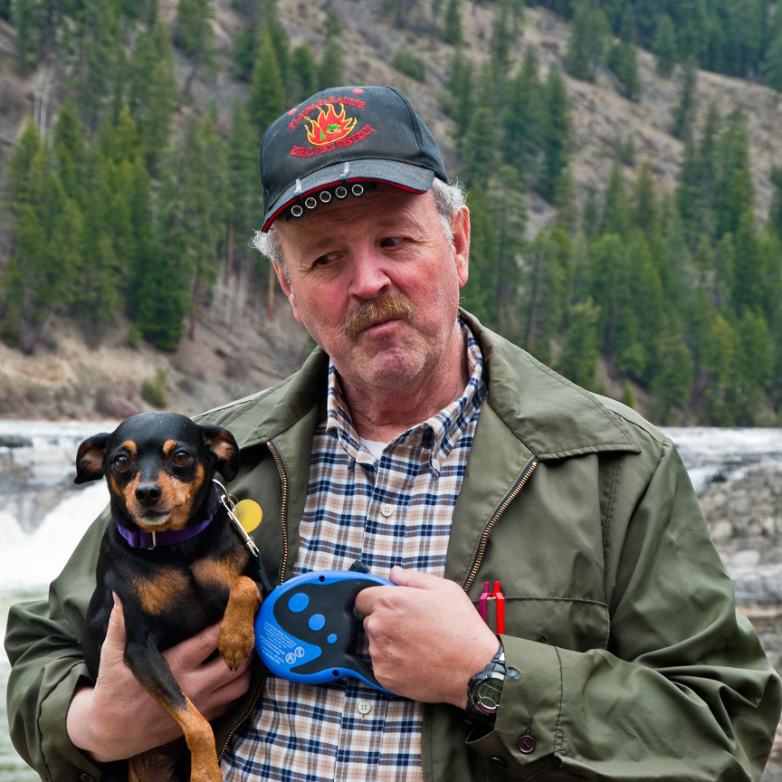 Kevin holding Harley at Kootenai Falls--the third of our four more MinPins