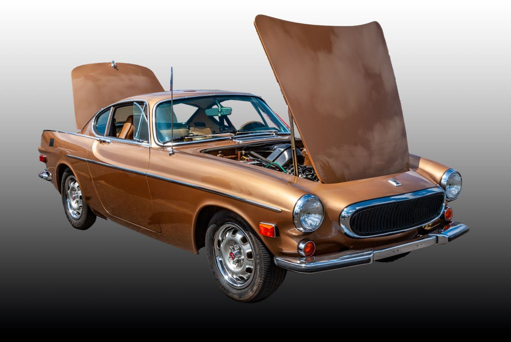 A Volvo P-1800 in gold