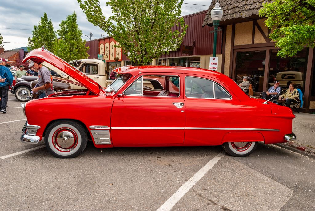 A bright red 1950 Shoebox Ford Custom tudor coupe
