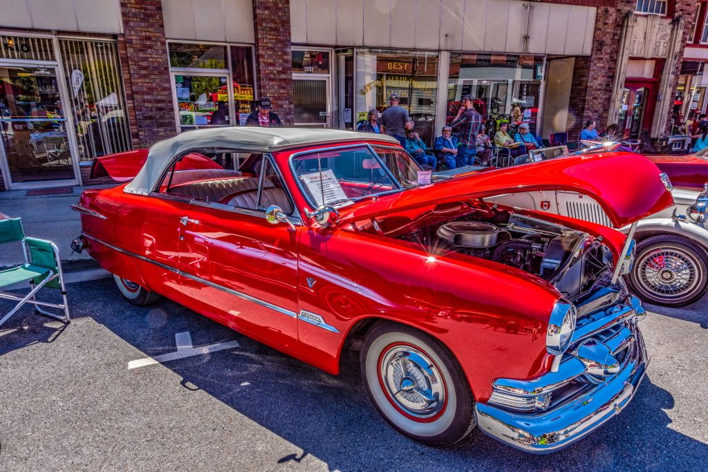 A bright red 1951 Shoebox Ford Custom convertible