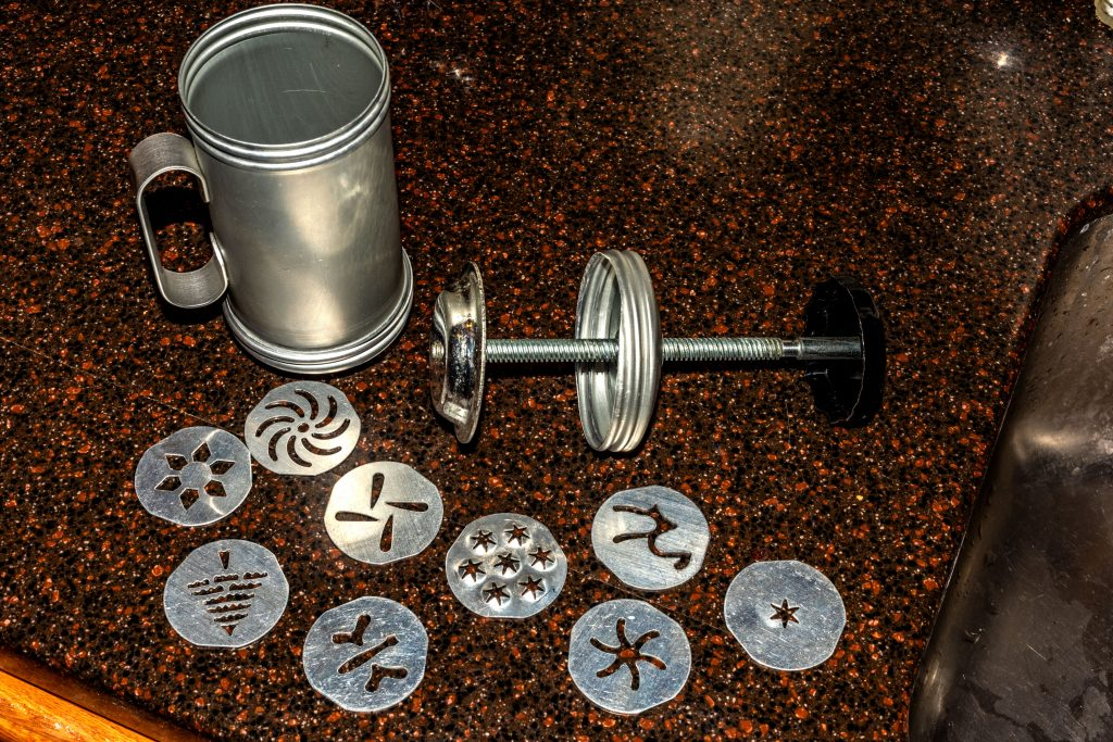 The Mirro Aluminum Cookie Press showing all its parts (exploded view)
