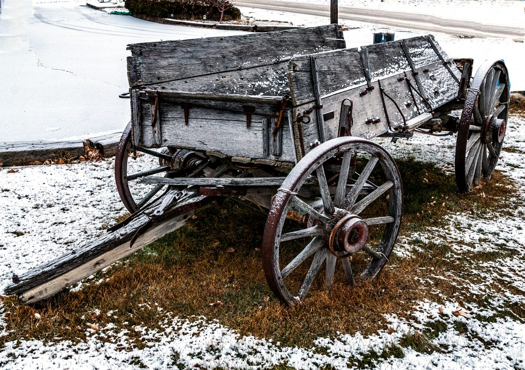 An old wooden wagon in the snow--a photograph from the second week in December