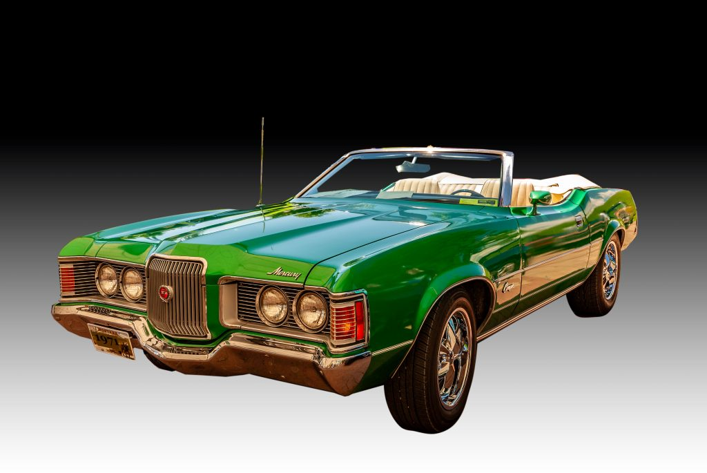 A 1971 bright green Mercury Cougar Convertible