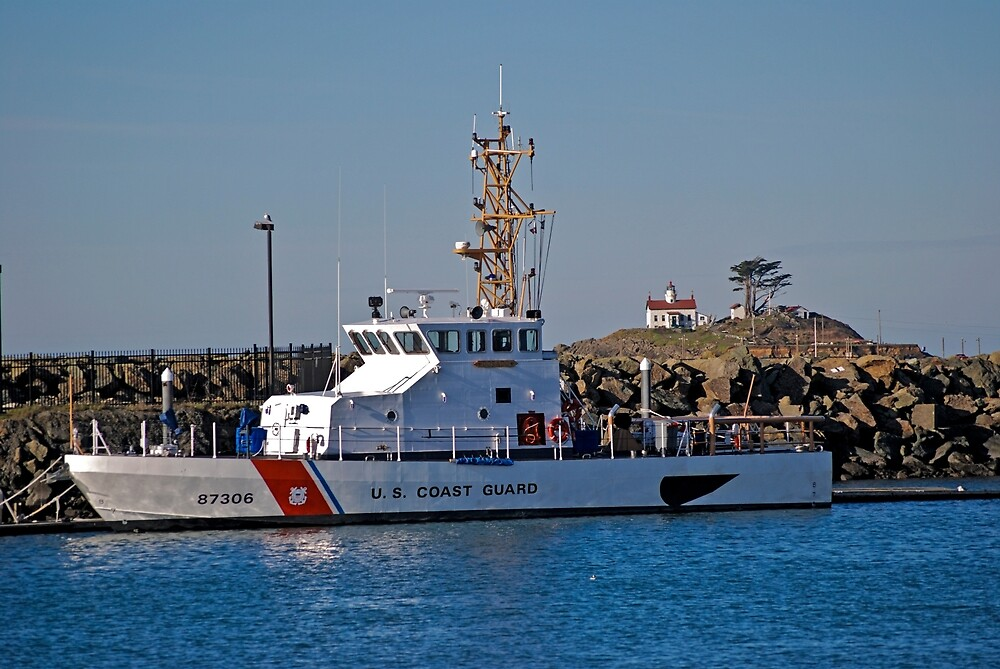 The Coast Guard Cutter Dorado and the Battery Point Lighthouse in Crescent City, California