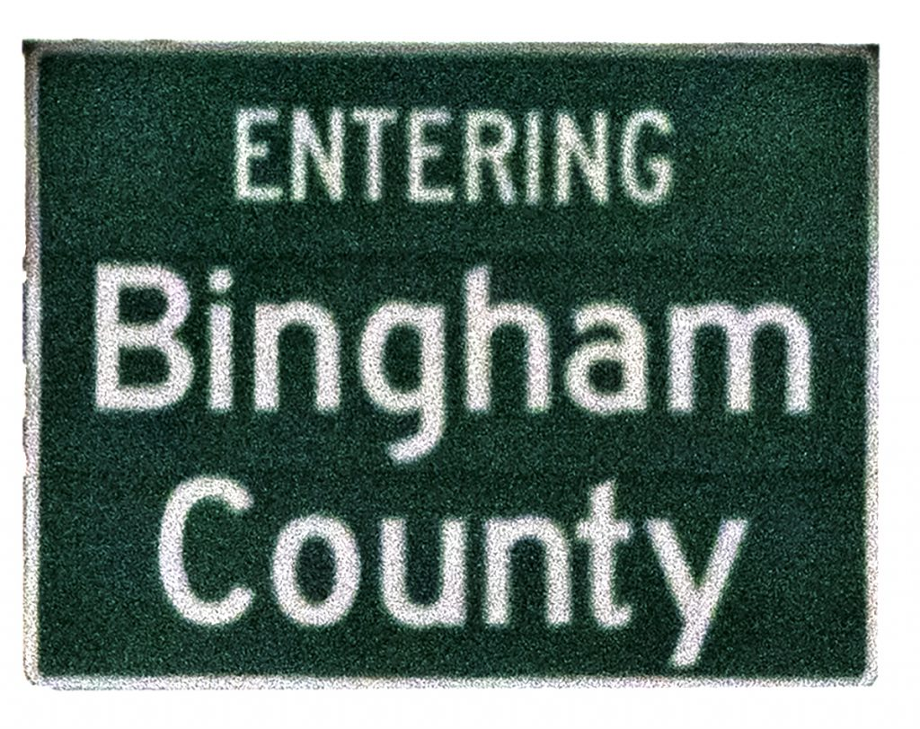 """The highway sign announcing that you are """"Entering Bingham County.""""  Something you see when on the road."""
