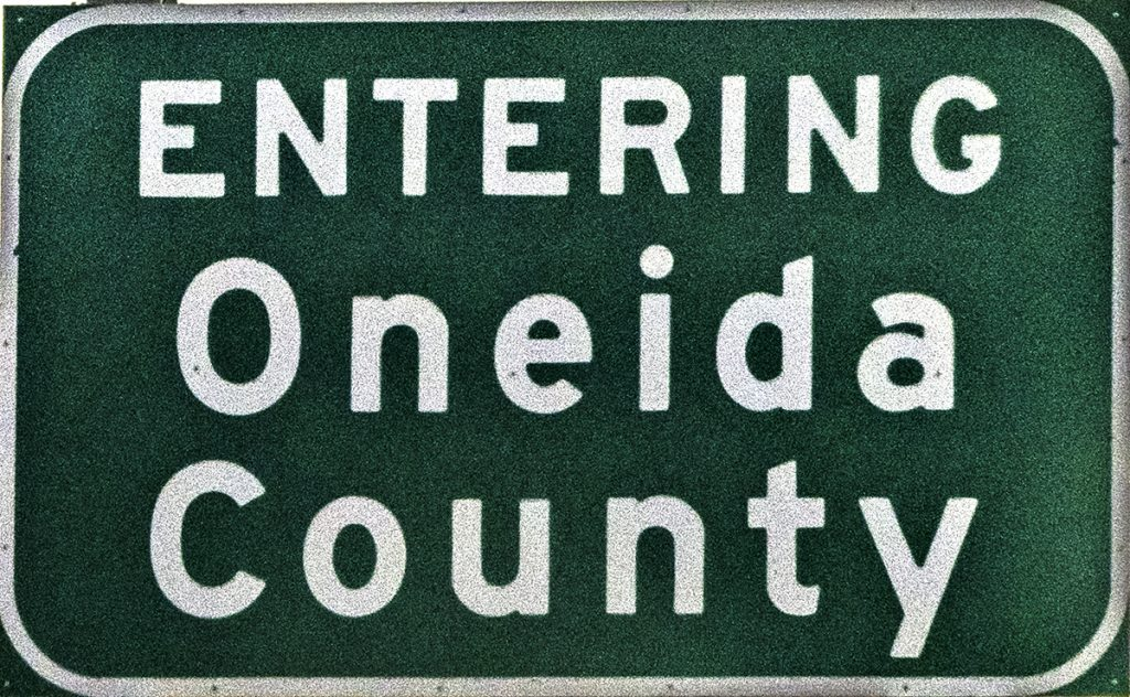 """The highway sign saying that you are """"Entering Oneida County,"""" as you see when you're on the road again."""